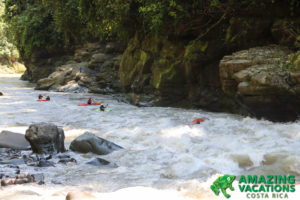 kayakers running rapids